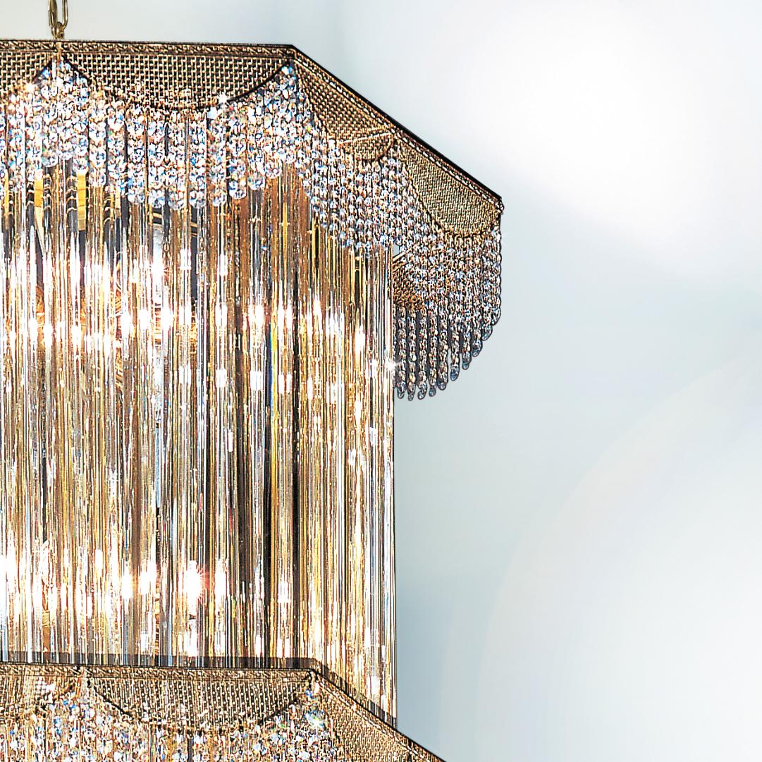 LAMPADARIO con triedri in cristallo o triedri e quadriedri in vetro di Murano, disponbili in molti colori, montatura in cromo lucido o oro 24 carati: Cristalli 5015/70